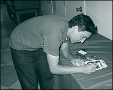 Chris giving autographs